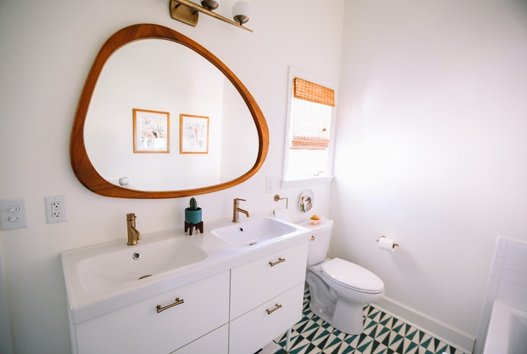 bathroom vanity with large, unique mirror